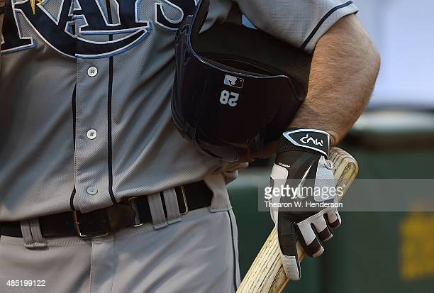 John Jaso of the Tampa Bay Rays wearing Nike MVP batting gloves holds onto his bat and helmet as he walks back to the dugout after striking out...