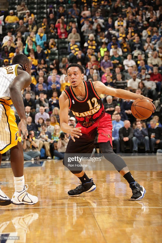 John Jenkins #12 of the Atlanta Hawks crosses his dribble over against the Indiana Pacers on February 5, 2013 at Bankers Life Fieldhouse in Indianapolis, Indiana.