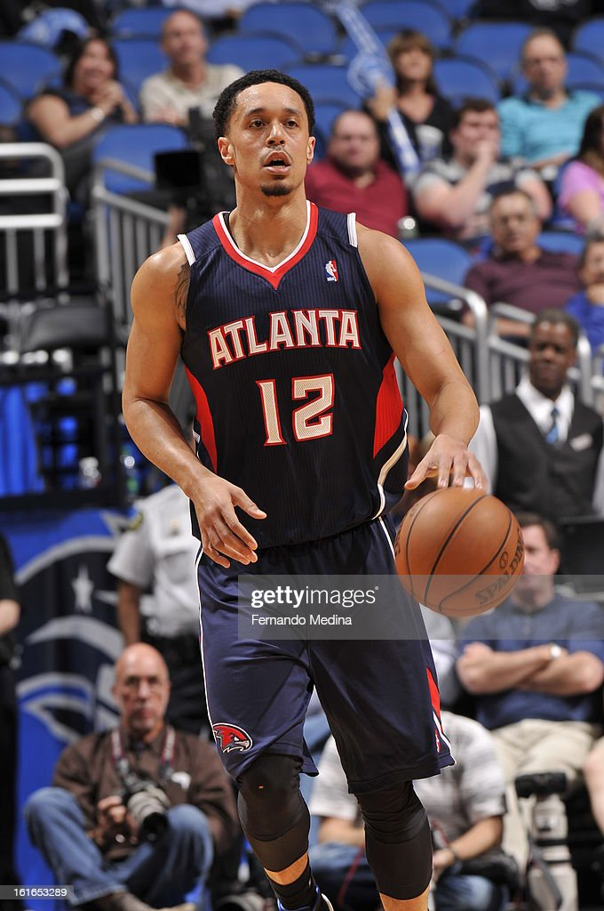 John Jenkins #12 of the Atlanta Hawks dribbles the ball up the court against the Orlando Magic during the game on February 13, 2013 at Amway Center in Orlando, Florida.