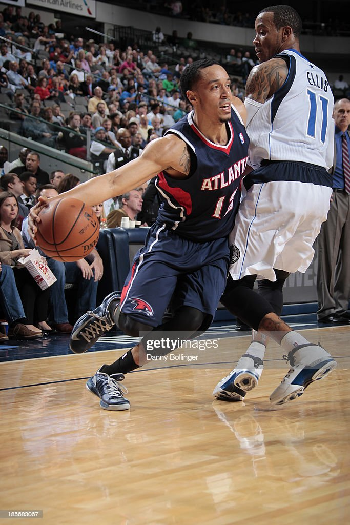 John Jenkins #12 of the Atlanta Hawks drives against <a gi-track='captionPersonalityLinkClicked' href=/galleries/search?phrase=Monta+Ellis&family=editorial&specificpeople=567403 ng-click='$event.stopPropagation()'>Monta Ellis</a> #11 of the Dallas Mavericks on October 23, 2013 at the American Airlines Center in Dallas, Texas.