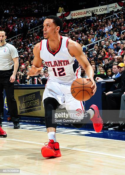 John Jenkins of the Atlanta Hawks drives against the Portland Trail Blazers on January 30 2015 at Philips Arena in Atlanta Georgia NOTE TO USER User...