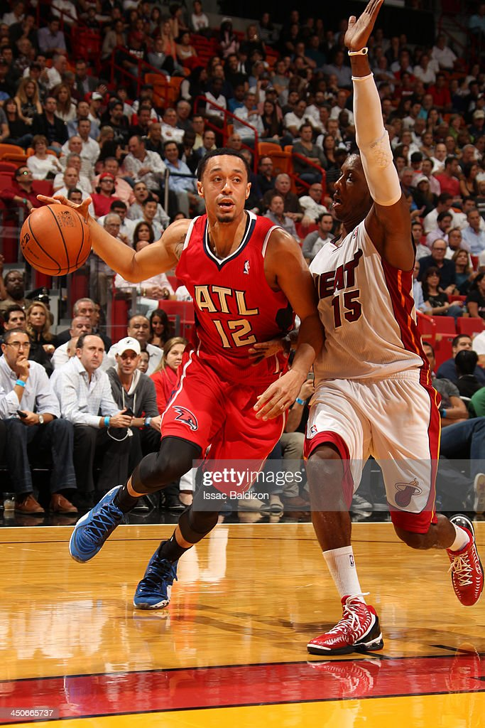 John Jenkins #12 of the Atlanta Hawks drives to the basket against <a gi-track='captionPersonalityLinkClicked' href=/galleries/search?phrase=Mario+Chalmers&family=editorial&specificpeople=802115 ng-click='$event.stopPropagation()'>Mario Chalmers</a> #15 of the Miami Heat on November 19, 2013 at American Airlines Arena in Miami, Florida.
