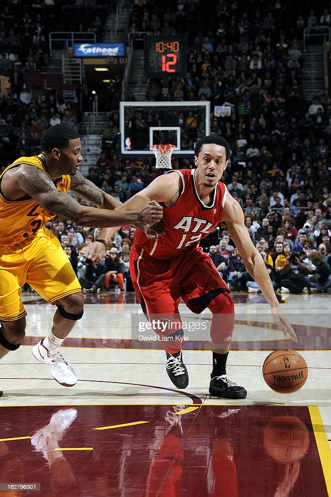 John Jenkins #12 of the Atlanta Hawks drives to the basket against the Cleveland Cavaliers at The Quicken Loans Arena on December 28, 2012 in Cleveland, Ohio.