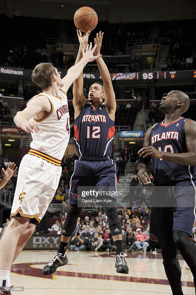 John Jenkins #12 of the Atlanta Hawks goes for a jump shot over Tyler Zeller #40 of the Cleveland Cavaliers at The Quicken Loans Arena on January 9, 2013 in Cleveland, Ohio.