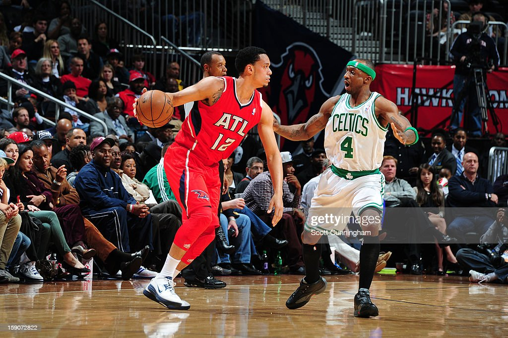 John Jenkins #12 of the Atlanta Hawks handles the ball against <a gi-track='captionPersonalityLinkClicked' href=/galleries/search?phrase=Jason+Terry&family=editorial&specificpeople=201734 ng-click='$event.stopPropagation()'>Jason Terry</a> #4 of the Boston Celtics on January 5, 2013 at Philips Arena in Atlanta, Georgia.