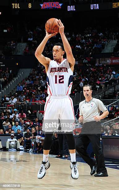 John Jenkins of the Atlanta Hawks looks to pass the ball against the New York Knicks during the game on April 13 2015 at Philips Arena in Atlanta...