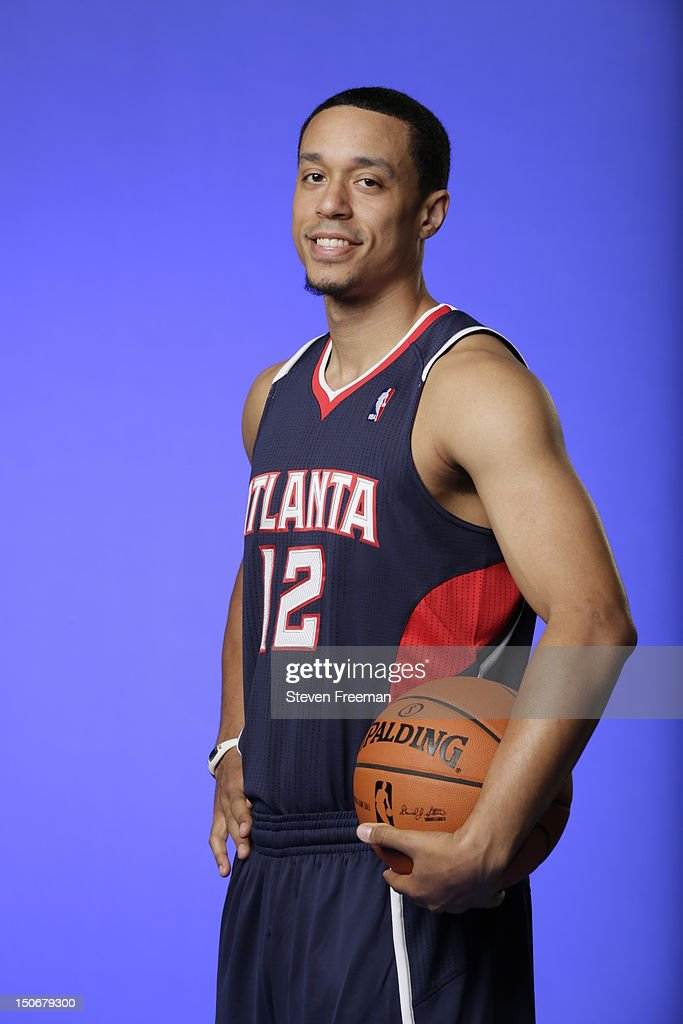 John Jenkins #12 of the Atlanta Hawks poses for a portrait during the 2012 NBA rookie photo shoot on August 21, 2012 at the MSG Training Facility in Tarrytown, New York.