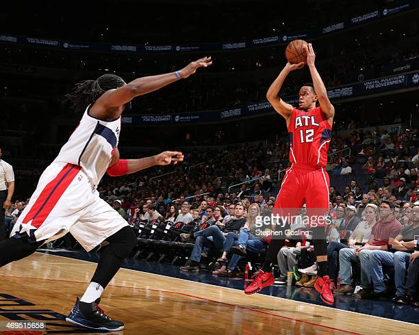 John Jenkins of the Atlanta Hawks shoots against the Washington Wizards during the game on April 12 2015 at Verizon Center in Washington DC NOTE TO...