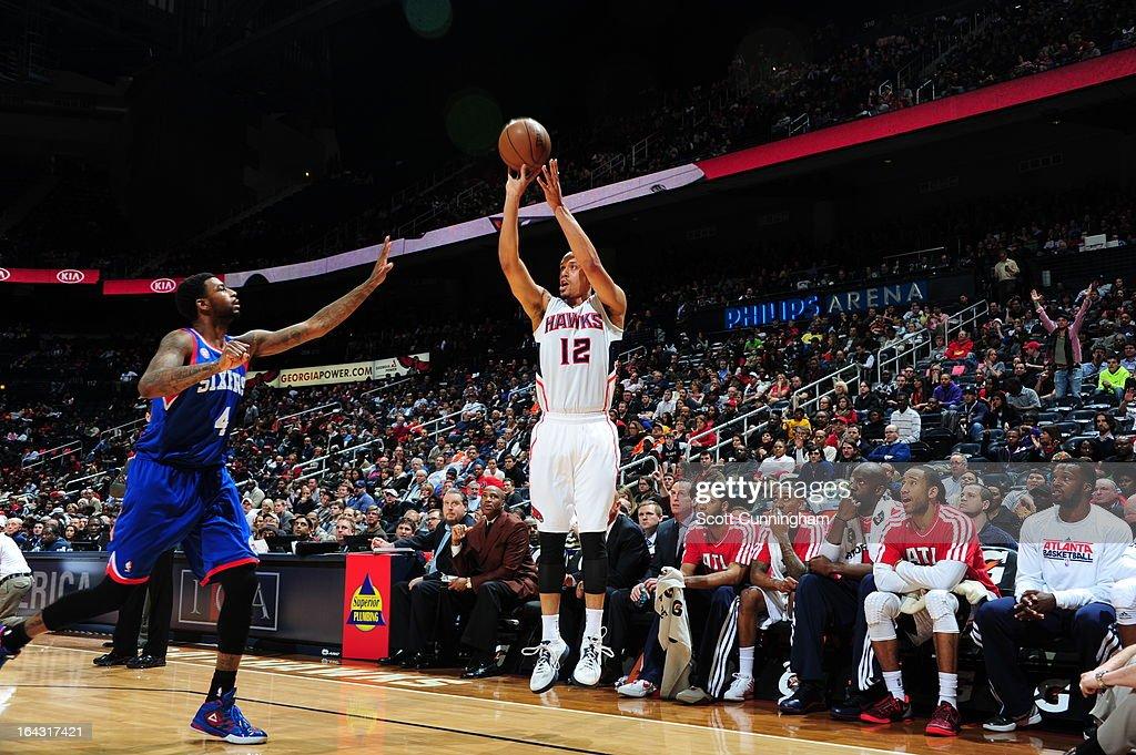 John Jenkins #12 of the Atlanta Hawks takes a shot against the Philadelphia 76ers on March 6, 2013 at Philips Arena in Atlanta, Georgia.