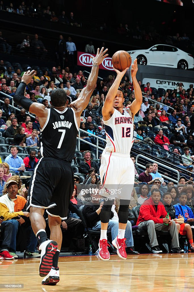 John Jenkins #12 of the Atlanta Hawks takes a shot against the Brooklyn Nets on March 9, 2013 at Philips Arena in Atlanta, Georgia.