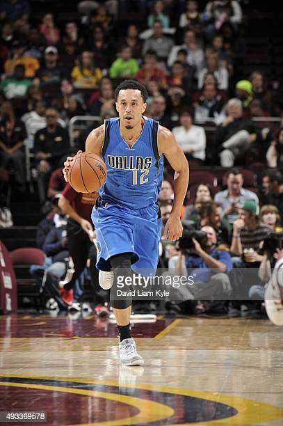 John Jenkins of the Dallas Mavericks brings the ball up court against the Cleveland Cavaliers on October 19 2015 at Quicken Loans Arena in Cleveland...