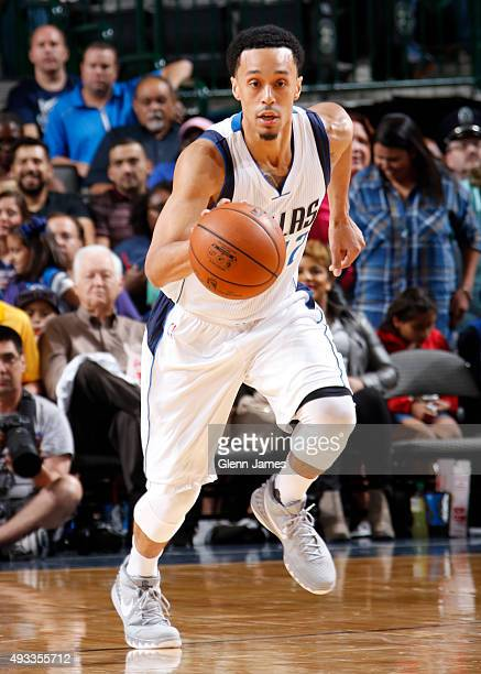 John Jenkins of the Dallas Mavericks dribbles the ball against the Atlanta Hawks during a preseason game on October 16 2015 at the American Airlines...
