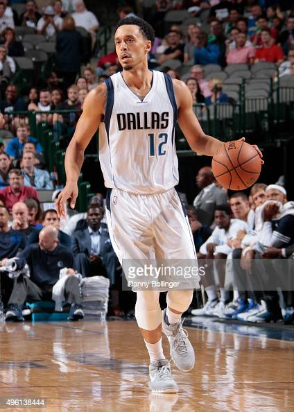 John Jenkins of the Dallas Mavericks dribbles the ball against the Phoenix Suns on October 21 2015 at the American Airlines Center in Dallas Texas...