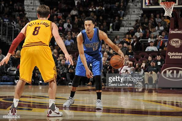 John Jenkins of the Dallas Mavericks handles the ball against Matthew Dellavedova of the Cleveland Cavaliers on October 19 2015 at Quicken Loans...
