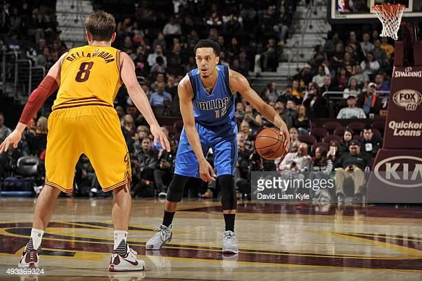 John Jenkins of the Dallas Mavericks handles the ball against Matthew Dellavedova of the Cleveland Cavaliers on October 19 2015 at Quicken Loans...