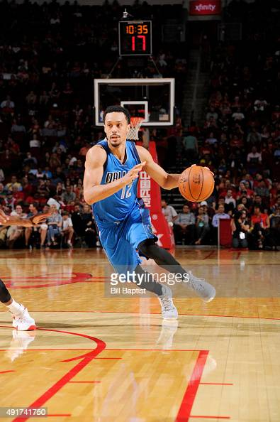 John Jenkins of the Dallas Mavericks handles the ball against the Houston Rockets during a preseason game on October 7 2015 at the Toyota Center in...