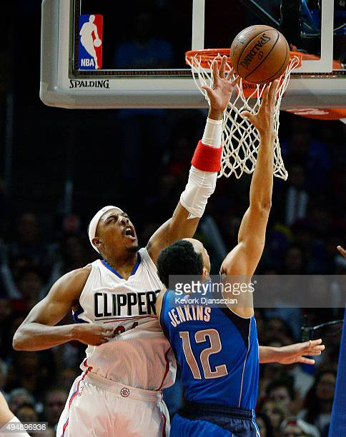 John Jenkins of the Dallas Mavericks is fouled by Paul Pierce of the Los Angeles Clippers during the third quarter of the basketball game at Staples...