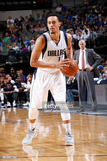 John Jenkins of the Dallas Mavericks looks to pass the ball against the Denver Nuggets during a preseason game on October 6 2015 at the American...