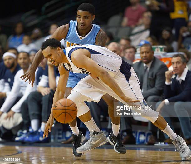 John Jenkins of the Dallas Mavericks scrambles for the ball against Gary Harris of the Denver Nuggets in the first half at American Airlines Center...
