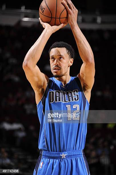 John Jenkins of the Dallas Mavericks shoots a free throw against the Houston Rockets during a preseason game on October 7 2015 at the Toyota Center...