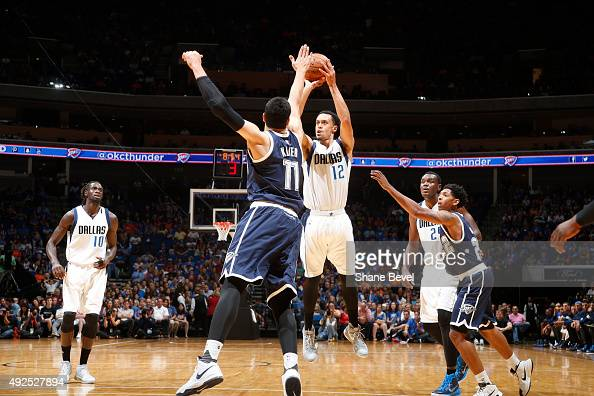 John Jenkins of the Dallas Mavericks shoots the ball against the Oklahoma City Thunder during a preseason game on October 13 2015 at the BOK Center...