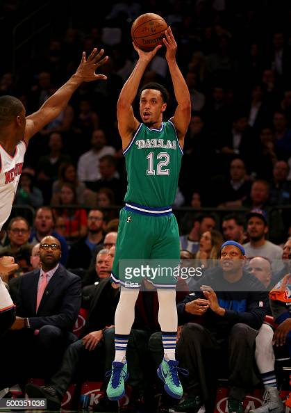 John Jenkins of the Dallas Mavericks takes a three point shot in the first half against the New York Knicks at Madison Square Garden on December 7...