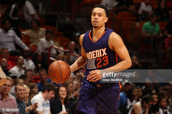 John Jenkins of the Phoenix Suns drives to the basket against the Miami Heat during the game on March 3 2016 at American Airlines Arena in Miami...