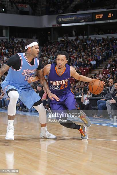 John Jenkins of the Phoenix Suns drives to the basket against Willie CauleyStein of the Sacramento Kings on March 25 2016 at Sleep Train Arena in...