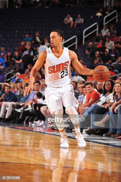 John Jenkins of the Phoenix Suns handles the ball against the Utah Jazz on October 5 2016 at Talking Stick Resort Arena in Phoenix Arizona NOTE TO...