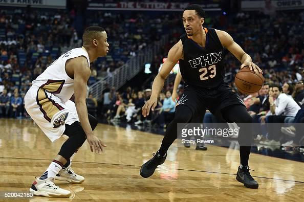 John Jenkins of the Phoenix Suns is defended by Tim Frazier of the New Orleans Pelicans during the first half of a game at Smoothie King Center on...