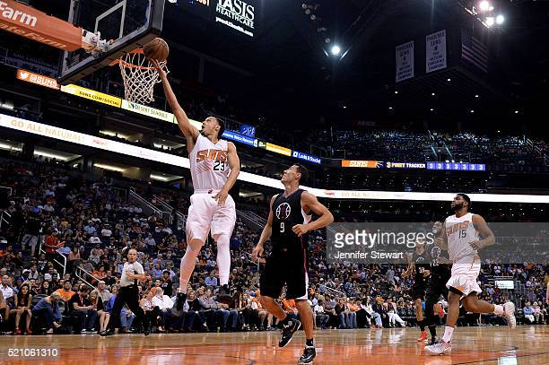 John Jenkins of the Phoenix Suns lays up the ball in front of Pablo Prigioni of the Los Angeles Clippers during the second half of the NBA game at...