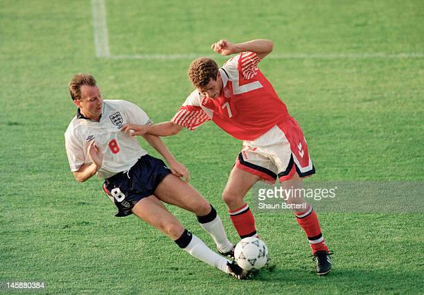 John Jensen of Denmark is tackled by Trevor Steven of England during the UEFA European Championships 1992 Group 1 match between Denmark and England...