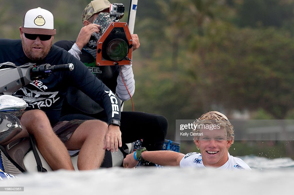 John John Florence of Hawaii joked with water cameramen before suffering an uncharacteristic loss at Pipeline during Round 3 of the Billabong Pipe Masters on December 9, 2012 in North Shore, Hawaii.
