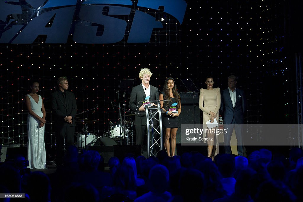 John John Florence of the United States of America alongside Malia Manuel of the United States of America accept their Rookie of the Year Award trophies at the ASP World Surfing Awards on February 28, 2013 in Surfers Paradise, Australia.