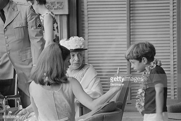 John John Kennedy became restless while watching the Kamehameha day parade in Honolulu June 11th and his mother Jackie wasted no time in pointing it...