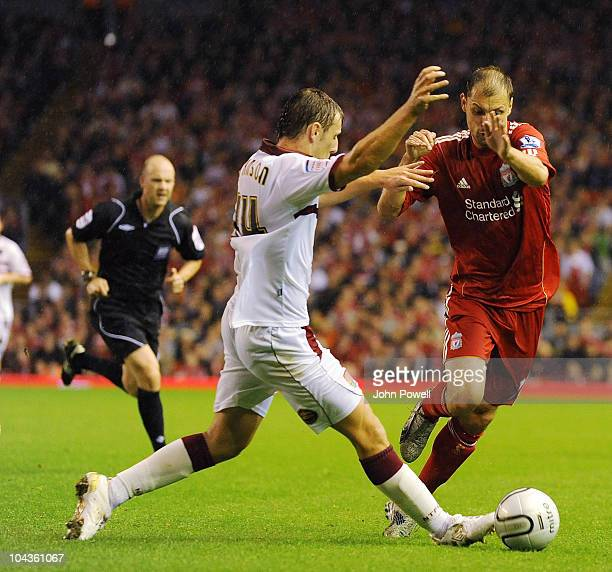 John Johnson of Northampton Town tussles with Milan Jovanovic of Liverpool during the Carling Cup 3rd round game between Liverpool and Northampton...