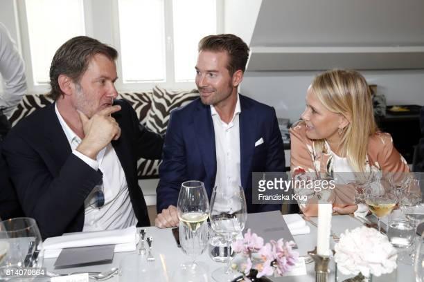 John Juergens Sebastian Hoeffner and Nova Meierhenrich during the Clos19 dinner on July 13 2017 in Munich Germany