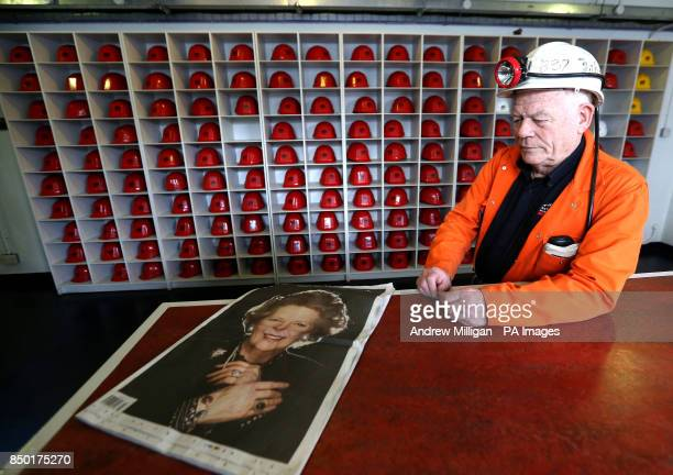 John Kane former miner and now guide at the National Mining Museum for Scotland at the Lady Victoria Colliery in Newtongrange holds a newspaper as he...