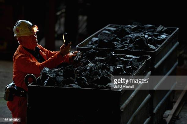 John Kane former miner and tour guide at the National Mining Museum Scotland looks at a piece of coal on April 9 2013 in Newtongrange Scotland...