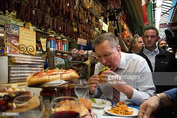 John Kasich enjoying the food at Mikes Deli at a meet and greet on Arthur Avenue