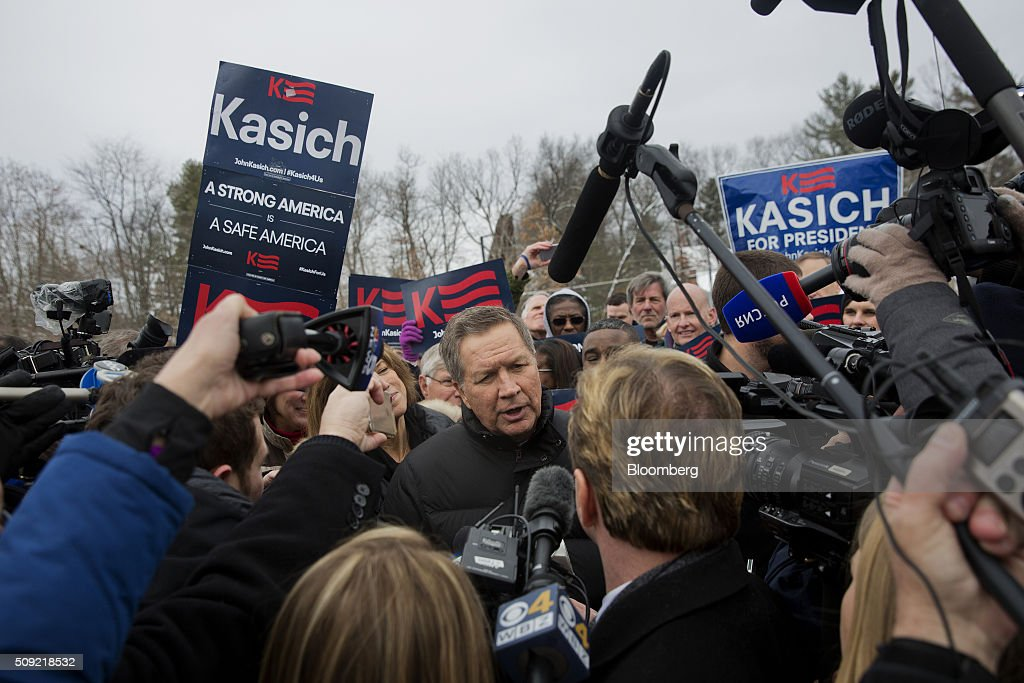 <a gi-track='captionPersonalityLinkClicked' href=/galleries/search?phrase=John+Kasich&family=editorial&specificpeople=1315571 ng-click='$event.stopPropagation()'>John Kasich</a>, governor of Ohio and 2016 Republican presidential candidate, center, speaks to the media while arriving at a polling station at Broken Gound Elementary School in Concord, New Hampshire, U.S., on Tuesday, Feb. 9, 2016. Voters in New Hampshire took to the polls today in the nation's first primary in the U.S. presidential race. Photographer: Victor J. Blue/Bloomberg via Getty Images