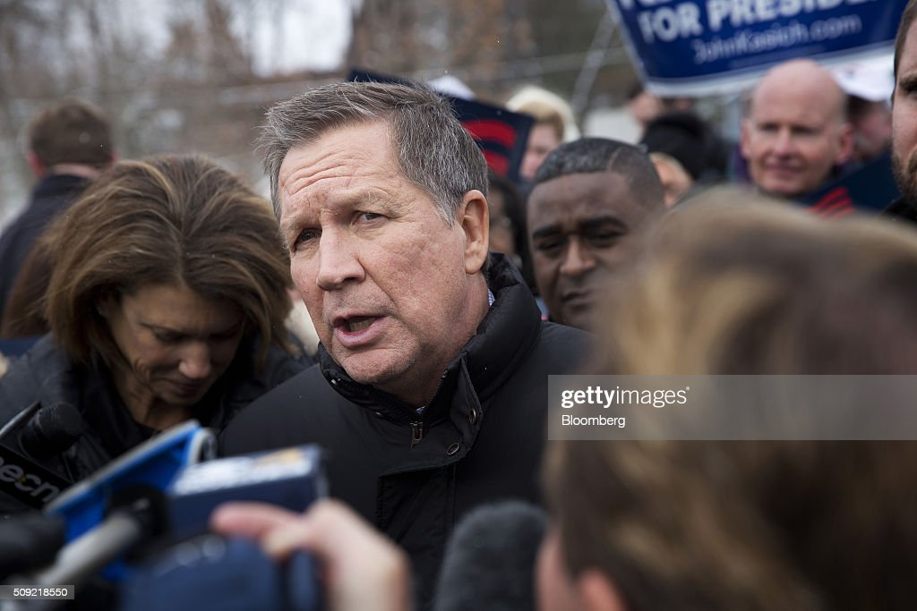 <a gi-track='captionPersonalityLinkClicked' href=/galleries/search?phrase=John+Kasich&family=editorial&specificpeople=1315571 ng-click='$event.stopPropagation()'>John Kasich</a>, governor of Ohio and 2016 Republican presidential candidate, center, greets voters while arriving with his wife Karen Waldbillig Kasich, left, at a polling station at Broken Gound Elementary School in Concord, New Hampshire, U.S., on Tuesday, Feb. 9, 2016. Voters in New Hampshire took to the polls today in the nation's first primary in the U.S. presidential race. Photographer: Victor J. Blue/Bloomberg via Getty Images