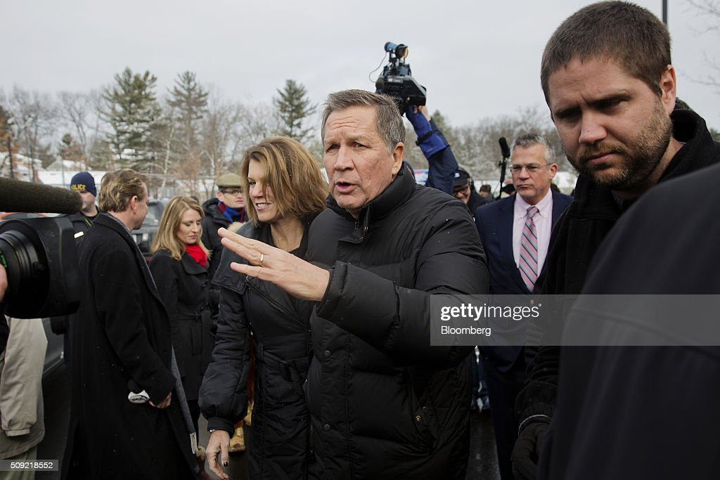 <a gi-track='captionPersonalityLinkClicked' href=/galleries/search?phrase=John+Kasich&family=editorial&specificpeople=1315571 ng-click='$event.stopPropagation()'>John Kasich</a>, governor of Ohio and 2016 Republican presidential candidate, center, greets voters while arriving with his wife Karen Waldbillig Kasich, center left, at a polling station at Broken Gound Elementary School in Concord, New Hampshire, U.S., on Tuesday, Feb. 9, 2016. Voters in New Hampshire took to the polls today in the nation's first primary in the U.S. presidential race. Photographer: Victor J. Blue/Bloomberg via Getty Images