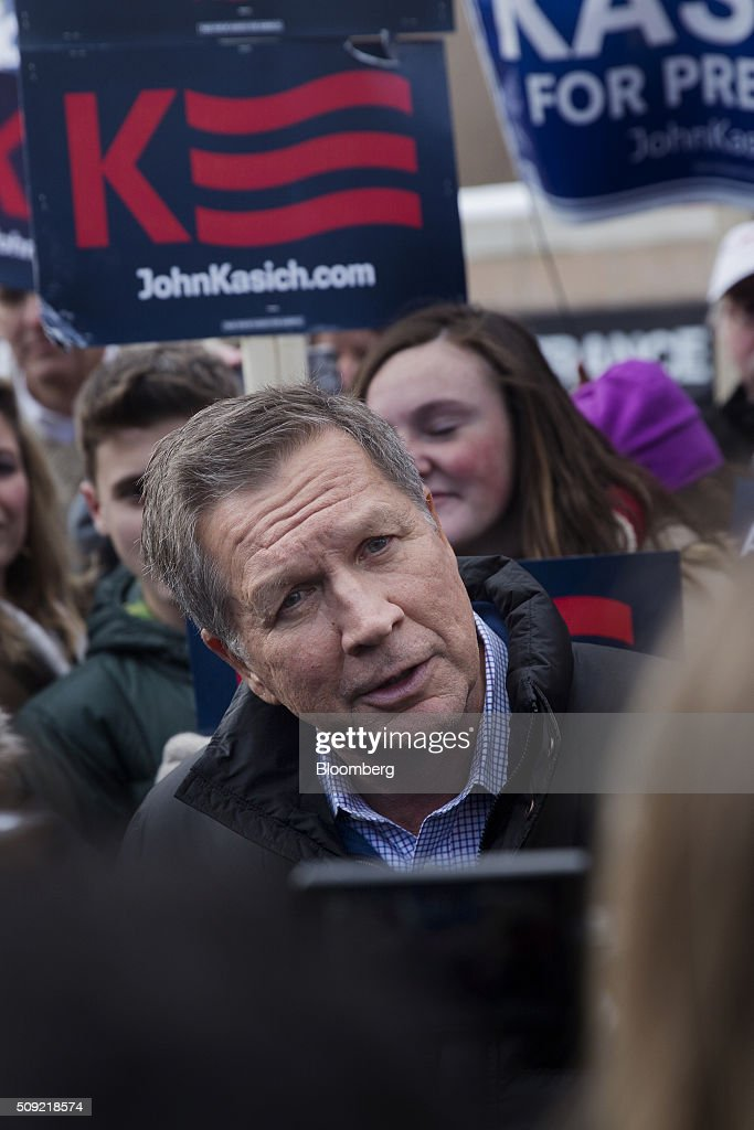 <a gi-track='captionPersonalityLinkClicked' href=/galleries/search?phrase=John+Kasich&family=editorial&specificpeople=1315571 ng-click='$event.stopPropagation()'>John Kasich</a>, governor of Ohio and 2016 Republican presidential candidate, center, greets voters while arriving at a polling station at Broken Gound Elementary School in Concord, New Hampshire, U.S., on Tuesday, Feb. 9, 2016. Voters in New Hampshire took to the polls today in the nation's first primary in the U.S. presidential race. Photographer: Victor J. Blue/Bloomberg via Getty Images