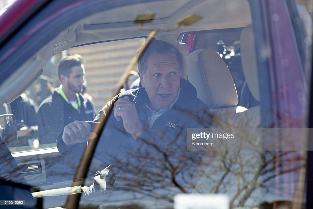 <a gi-track='captionPersonalityLinkClicked' href=/galleries/search?phrase=John+Kasich&family=editorial&specificpeople=1315571 ng-click='$event.stopPropagation()'>John Kasich</a>, governor of Ohio and 2016 Republican presidential candidate, leaves following a campaign rally outside Mutt's BBQ in Mauldin, South Carolina, U.S., on Saturday, Feb. 13, 2016. Kasich and fellow establishment candidates, Marco Rubio and Jeb Bush, are determined to make a stand in South Carolina in order to convince donors and supporters that they have a legitimate shot at winning the nomination. Photographer: Daniel Acker/Bloomberg via Getty Images