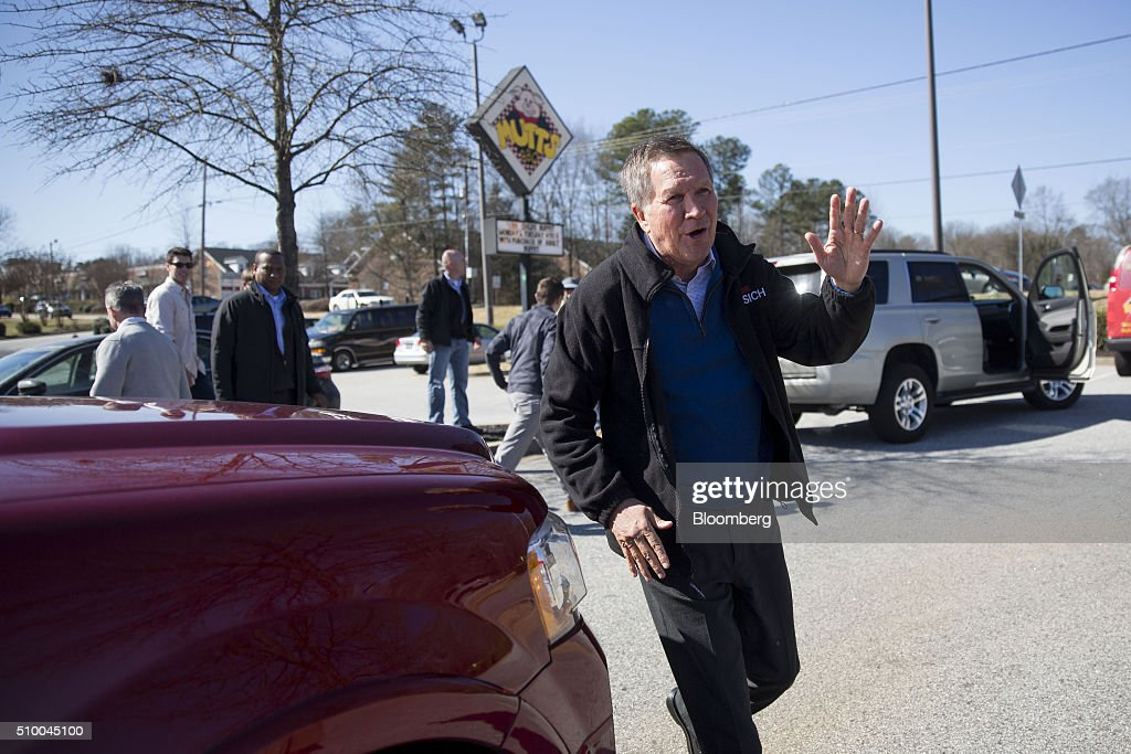 <a gi-track='captionPersonalityLinkClicked' href=/galleries/search?phrase=John+Kasich&family=editorial&specificpeople=1315571 ng-click='$event.stopPropagation()'>John Kasich</a>, governor of Ohio and 2016 Republican presidential candidate, waves to attendees following a campaign rally outside Mutt's BBQ in Mauldin, South Carolina, U.S., on Saturday, Feb. 13, 2016. Kasich and fellow establishment candidates, Marco Rubio and Jeb Bush, are determined to make a stand in South Carolina in order to convince donors and supporters that they have a legitimate shot at winning the nomination. Photographer: Daniel Acker/Bloomberg via Getty Images