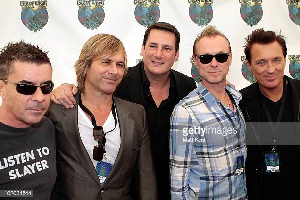 John Keeble Steve Norman Tony Hadley Gary Kemp and Martin Kemp of Spandau Ballet pose backstage at day 3 of the Isle Of Wight Festival at Seaclose...
