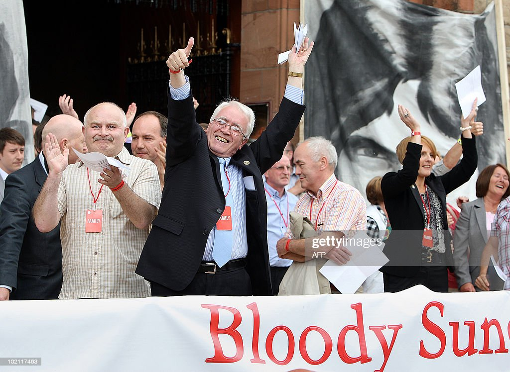 John Kelly (C), brother of Michael Kelly, celebrates after reading a copy of the long-awaited Saville Inquiry report into Bloody Sunday, outside the Guildhall in Londonderry on June 15, 2010. Publication of the report was greeted with cheers in Londonderry, Northern Ireland's second city, where relatives of those who died joined thousands waiting to see the contents of the 5,000-page report. AFP PHOTO / POOL / Paul Faith