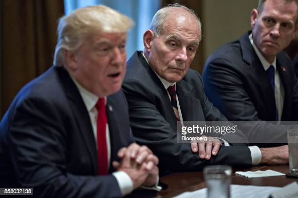 John Kelly White House chief of staff center listens as US President Donald Trump left speaks during a briefing with senior military leaders in the...