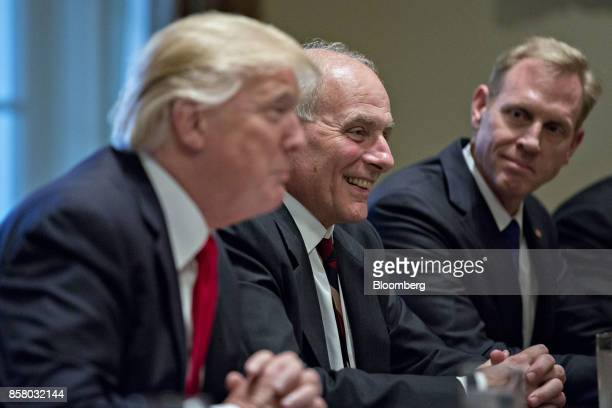 John Kelly White House chief of staff center smiles as US President Donald Trump left speaks during a briefing with senior military leaders in the...